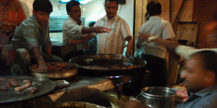 Kababs are fried on large 'tavas' at this Aminabad restaurant (Lucknow).