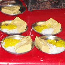 Kulfi from a street-side vendor, served with saffron tinted faluda noodles, sprinkled with rosewater.