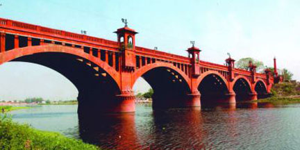 Lal Pul, meaning 'Red Bridge', spans the Gomti river in Lucknow.