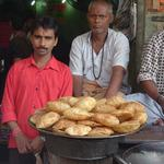 Puris, inflated fried breads, are made and sold by the hundreds in small cafes, like this one in Banares.
