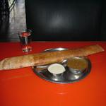 "A ""rocket dosa"" is a paper-thin crispy crepe, rolled around a spicy potato filling, and served with the traditional South Indian accompaniments, sambar and coconut chutney."